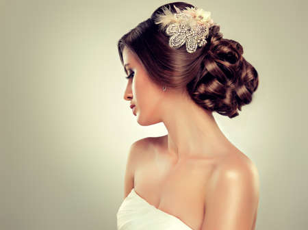 neckline: Girl bride in wedding dress with elegant hairstyle. Stock Photo