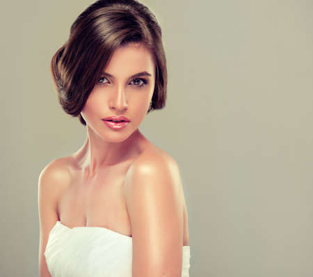 bride: Girl bride in wedding dress with elegant hairstyle. Stock Photo