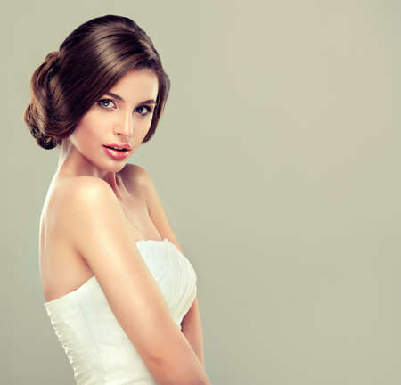 fashion make up: Girl bride in wedding dress with elegant hairstyle. Stock Photo