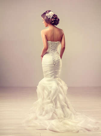 Girl bride in wedding dress with elegant hairstyle. photo