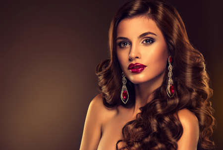 indian sexy: Beautiful girl model with long brown curled hair with large necklace