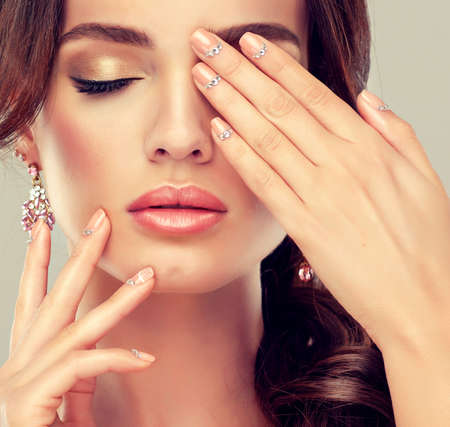 pink nail polish: Makeup for eyes and lips, eyeliner and coral lipstick. Stock Photo