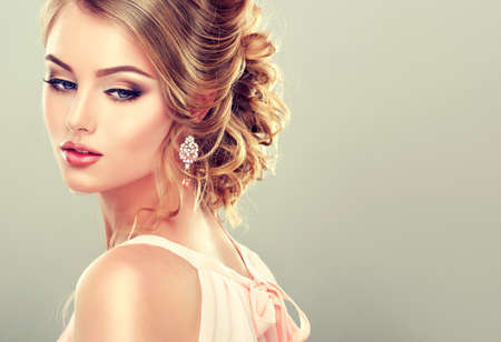 hairdress: Beautiful model with elegant hairstyle Stock Photo