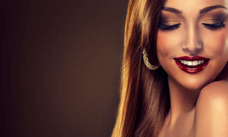 Model with beautiful white teeth with red lips