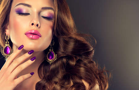 eyeshadow: Beautiful model brunette with long curled hair