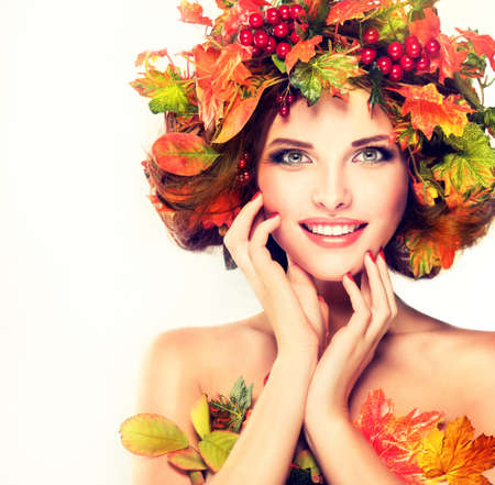 fall beauty: Autumn Beauty - fashion Makeup With Red and yellow autumn Leaves on girl head