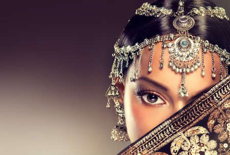 Beautiful Indian women portrait with jewelry. elegant Indian girl looking to the side, bollywood style