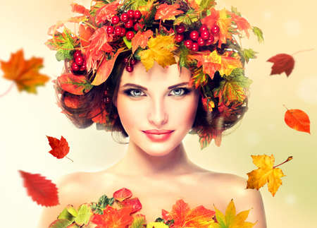 Autumn Beauty - fashion Makeup With Red and yellow autumn Leaves on girl head
