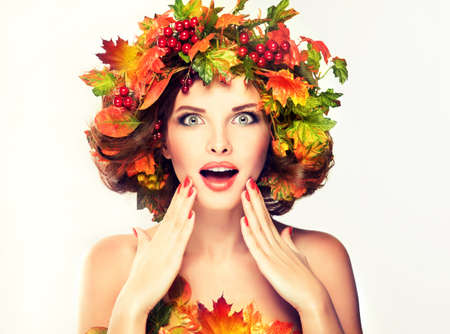 glamour woman: Autumn Beauty - fashion Makeup With Red and yellow autumn Leaves on girl head
