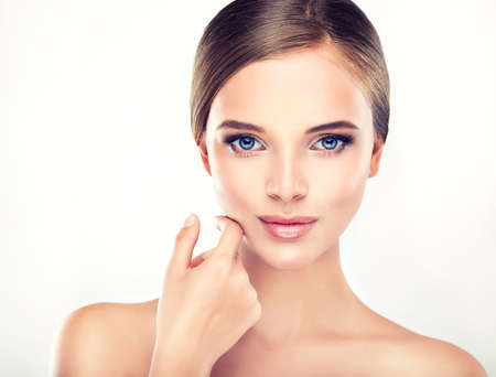 woman face cream: Beautiful Young Woman with Clean Fresh Skin close up Stock Photo