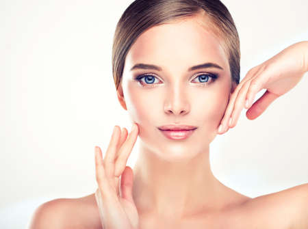 healthcare and beauty: Beautiful Young Woman with Clean Fresh Skin close up Stock Photo