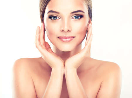 spa: Beautiful Young Woman with Clean Fresh Skin close up Stock Photo