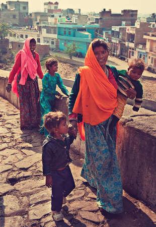 indigenous culture: India.Jaipur. Indian gipsy women, walking on street in Jaipur suburb.