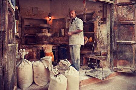 indian culture: India, Rajastan.Dusty wheat flour merchant