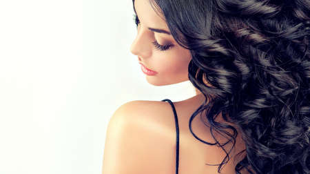 shampoo hair: Beautiful girl model with long black curled hair Stock Photo