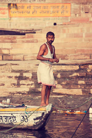 varanasi: Varanasi, Uttar Pradesh state, India.Indian fisherman near Varanasi ghats. Editorial