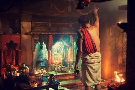 benares: Varanasi, Uttar Pradesh state, India. Hindu priest at work in one of Varanasi temples.