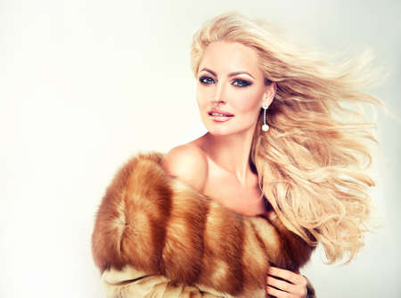 Winter Woman in Luxury Fur Coat. Beauty Fashion Model Girl