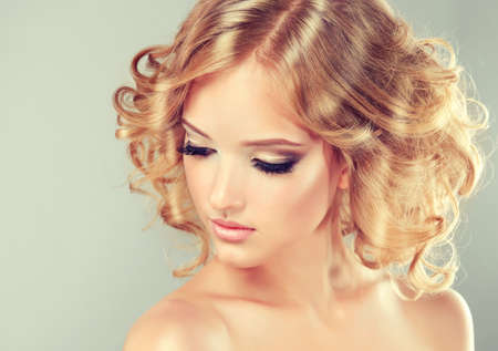 medium length: Pretty blonde girl with hairstyle curled hair .Hairstyle medium length