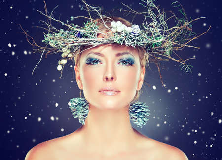 winter people: Christmas fashion model girl with snowy wreath on the head Stock Photo