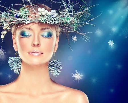 blue eye: Christmas fashion model girl with snowy wreath on the head Stock Photo