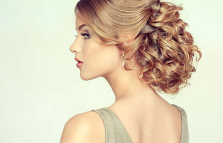 loose hair: Beautiful girl light brown hair with an elegant hairstyle , hair wave ,curly hairstyle