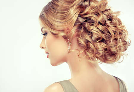 Beautiful girl light brown hair with an elegant hairstyle , hair wave ,curly hairstyle photo