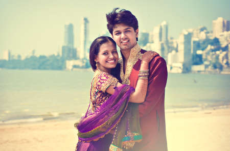 salwar: Young indian married couple after weddind ceremony. Young happy family.Indian groom and bride in traditional wedding dress. Stock Photo