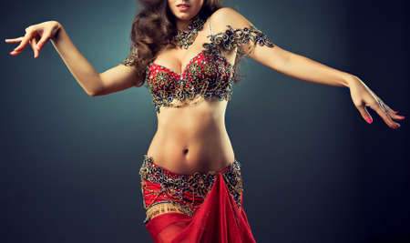 bellydance: Dancing girl in the carnival costume. Expressive movement of dance.