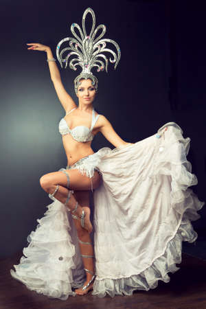 carnival: Dancing girl in the carnival costume. Expressive movement of dance.