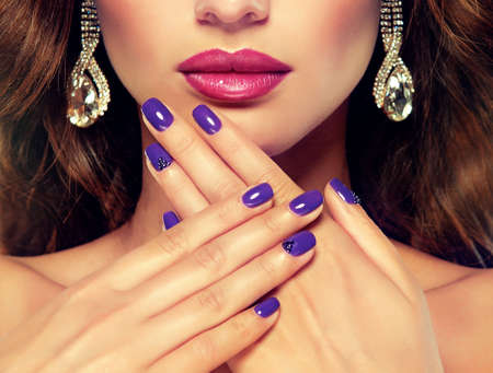 Luxury fashion style, nails manicure, cosmetics, make-up and curly hair.