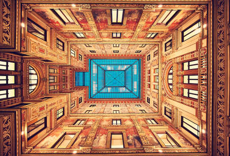 view of an atrium in a building: Rome. Italy. Perfect classical decoration of inner yard public building. Beauty of symmetry.