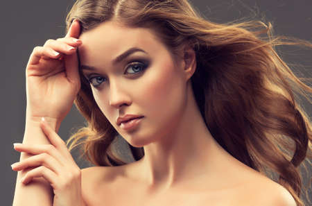 beautiful model: Beautiful girl, brown hair with an elegant hairstyle , hair wave ,curly