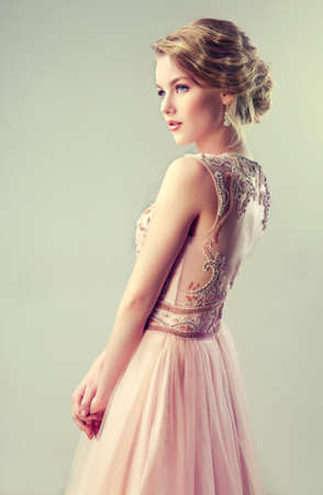dress up: Young beautiful woman, dressed in evening gown.Example of wedding hairstyle. Stock Photo