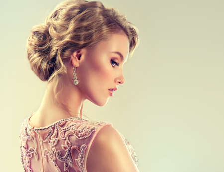 wedding hairstyle: Example of wedding hairstyle. Beautiful girl light brown hair with an elegant hairstyle.