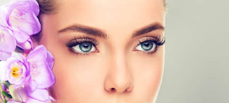 naturally: Big blue eyes with log eyelashes. Soft and tender look.Make-up and cosmetics. Stock Photo