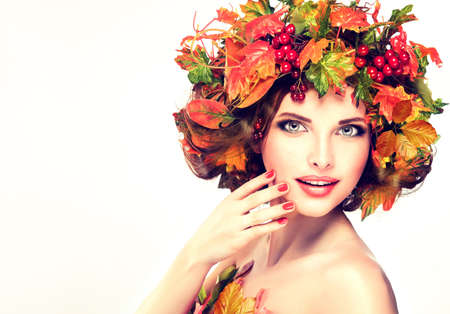 Autumn style, bright makeup, red manicure and lipstick. Banco de Imagens