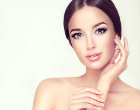 Beautiful Young Woman with Clean Fresh Skin close up portrait. Cosmetic, cosmetology and skin care. Standard-Bild