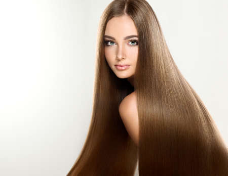 Young attractive girl-model with gorgeous, shiny, long, straight hair. Good and healthy hair as resalt of right care. Stok Fotoğraf