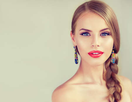 Close up portrait of beautiful young woman with braid(pigtail), bright red lips and blue eyes. Fashion ,beauty and cosmetic. Banco de Imagens