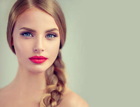 Close-up portrait of beautiful young woman with braid(pigtail) and big earrings on her. Bright red lips and blue eyes. Fashion ,beauty and cosmetic. Banco de Imagens - 79618666