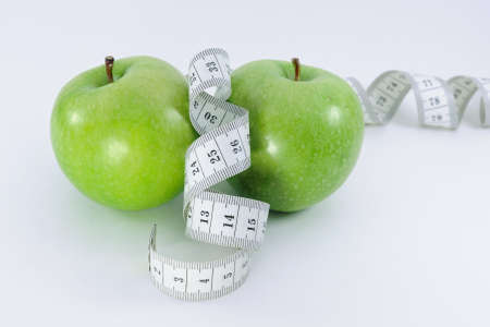 Apples with measurement tape Stock Photo - 12932196