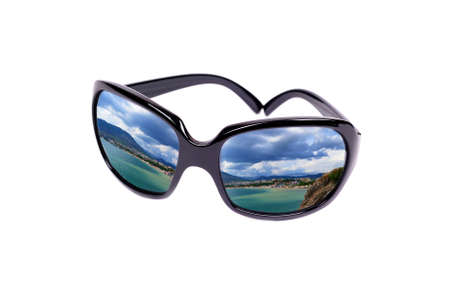 Reflection of the coast in glasses photo