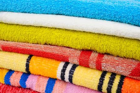 orange washcloth: Colorful towels isolated on white background