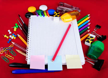 clerical: School education supplies items isolated on red background