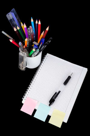 clerical: School education supplies items isolated on a black background