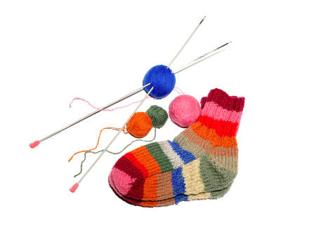 Warm knitted woolen socks knitting needles isolated on a white background photo