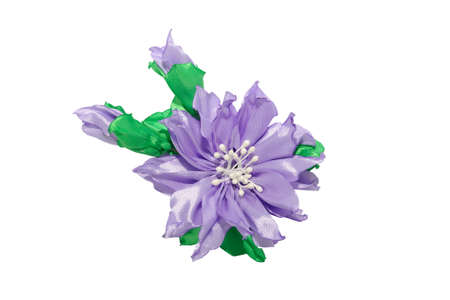 Kanzashi. Purple artificial flower isolated on white background