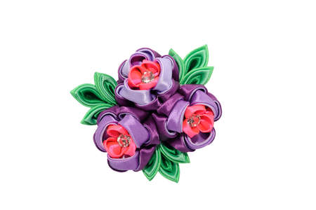 Kanzashi. Pink purple artificial flower isolated on white background