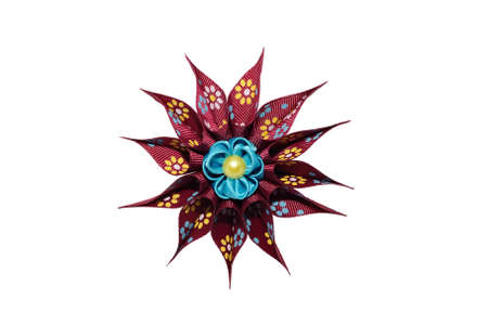 Kanzashi. Blue artificial flower on maroon star isolated on white background